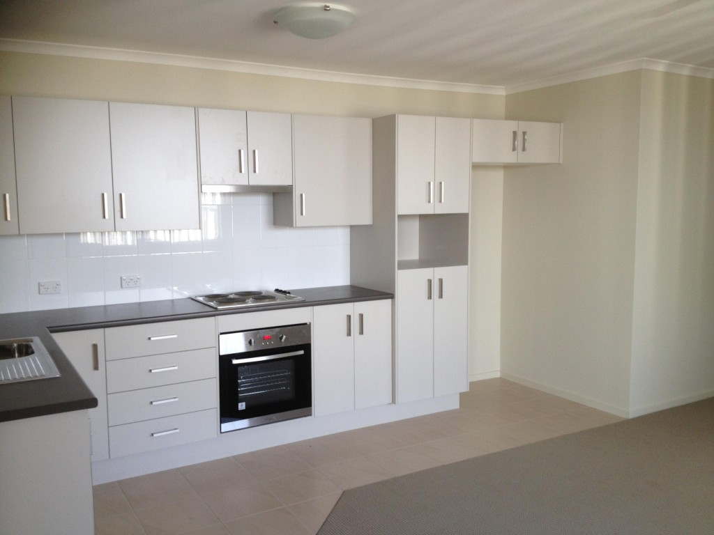 white on white kitchen. 4 element stove top and single sink. Vacant property.